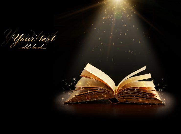 Opened magic book with magic light. Education